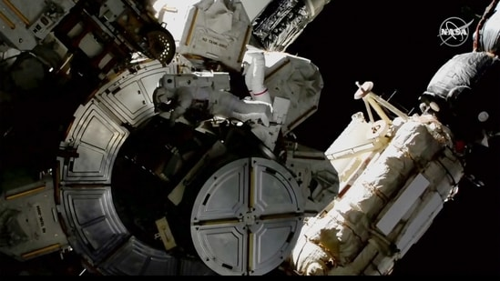 The astronauts are rearranging space station plumbing and tackling other odd jobs. (Nasa via AP)