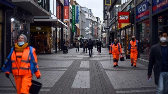 Germany's death toll from the virus stands at 73,301, with a reported 2,558,455 infections. In picture - Street in Cologne, West Germany.(AFP)