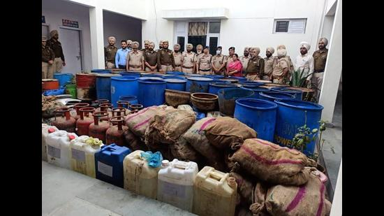 Members of the Amritsar rural police team after busting an illicit liquor manufacturing unit at Kotli Sakka village in Ajnala sub division on Saturday. (HT Photo)