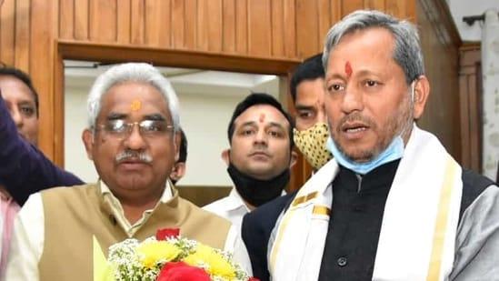 Newly-appointed Uttarakhand BJP state president Madan Kaushik and Uttarakhand CM Tirath Singh Rawat in Dehradun.(ANI)
