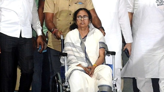 West Bengal Chief Minister Mamata Banerjee comes out on a wheelchair after being discharged from the SSKM Hospital in Kolkata on Friday. (ANI Photo)