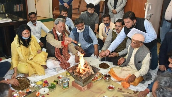 New CM Tirath Singh Rawat participating in hawan ceremony before taking charge of his office at the secretariat here on Sunday.(HT Photo)
