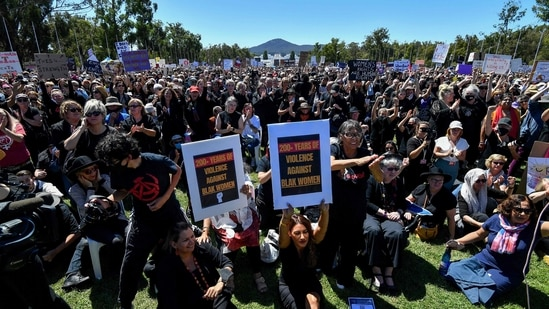 Protesters attend a rally against sexual violence and gender inequality in Australia's capital city Canberra on March 15, 2021. (Saeed KHAN / AFP)