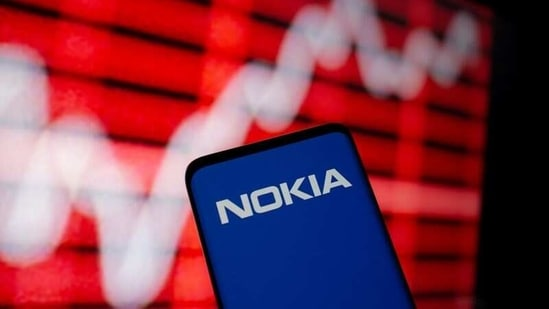 FILE PHOTO: The Nokia logo is seen on a smartphone in front of a displayed stock graph in this illustration taken February 5, 2021. REUTERS/Dado Ruvic/Illustration(REUTERS)