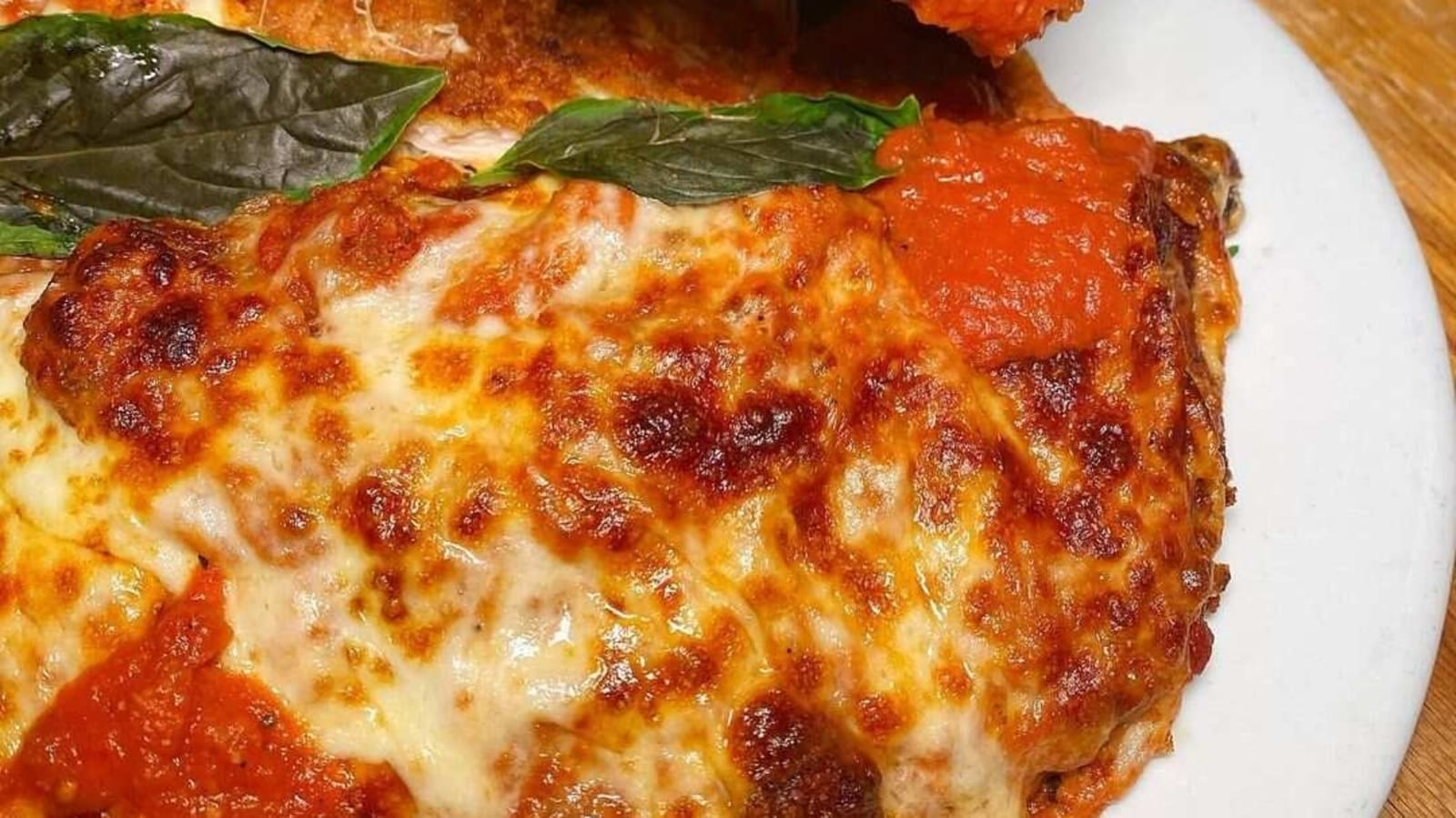 Try out this yummy Italian Chicken Parmigiana recipe oozing with cheesy goodness