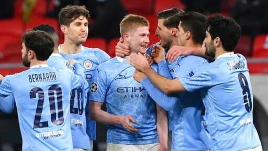 Kevin De Bruyne of Manchester City, centre, celebrates with teammates after scoring a goal against Borussia Moenchengladbach during the Champions League round of 16 second leg soccer match between Manchester City and Borussia Moenchengladbach in the Puskas Ferenc Arena in Budapest, Hungary, Tuesday, March 16, 2021.(AP)