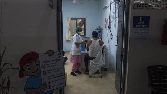 A person being vaccinated against Covid-19 at Rajawadi Hospital. (Pratik Chorge/HT Photo)
