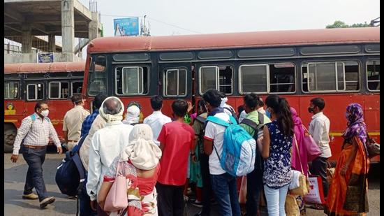 Passengers violate social distancing norms at a bus station in Nagpur on Wednesday, March 17. (ANI)
