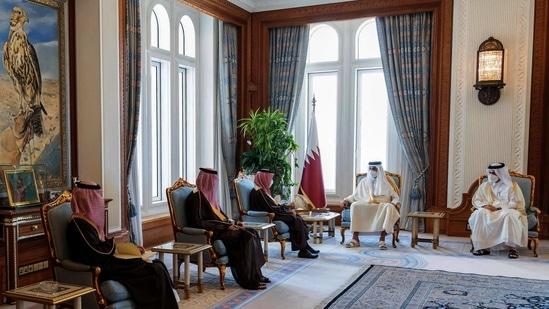 This handout picture released by the Qatar Amiri Diwan on March 8, 2021, shows Emir of Qatar Sheikh Tamim bin Hamad al-Thani (2nd-R) meeting with Saudi Arabia's Foreign Minister Prince Faisal bin Farhan Al-Saud (3rd-L) in the Qatari capital Doha. (AFP Photo / Qatar Amiri Diwan)
