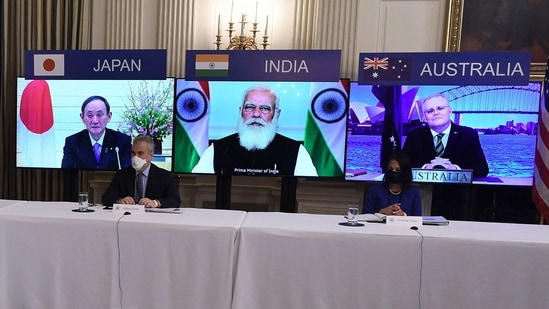 "Japanese Prime Minister Yoshihide Suga, Indian Prime Minister Narendra Modi and Australian Prime Minister Scott Morrison listen during a virtual meeting of the ""Quad"" alliance members: Australia, India, Japan and the US, in the State Dining Room of the White House in Washington. (AFP)"