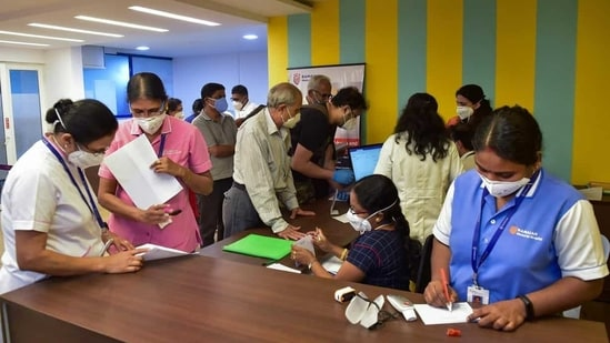 Health Minister K Sudhakar held a meeting to review the Covid-19 situation and progress of vaccination drive in the state. In picture - Beneficiaries registering for vaccine at a private hospital in Bengaluru.(PTI)