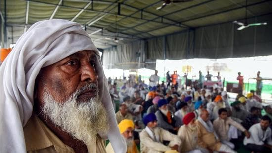 Farmers sitting during a protest against the new farm laws, at the Delhi-Ghazipur border in New Delhi on Thursday. (ANI)