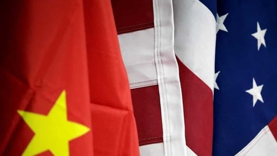 Flags of US and China are displayed at American International Chamber of Commerce (AICC)'s booth during China International Fair for Trade in Services in Beijing, China.(Reuters/ File photo)