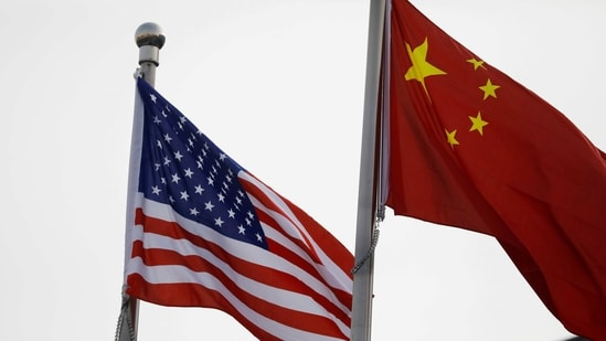 Chinese and US flags flutter outside the building of an American company in Beijing, China January 21, 2021.(Reuters)