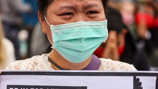 A woman cries during a gathering to denounce the Myanmar military coup, in Taipei, Taiwan.(Reuters)
