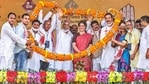 Congress General Secretary Priyanka Gandhi Vadra being garlanded at an election rally for Assam assembly polls in Koliabor on Monday. (PTI PHOTO.)