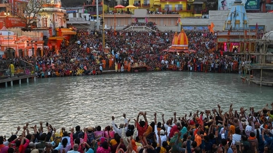 In this file photo taken on March 11, 2021 Hindu devotees attend evening prayers after taking a holy dip in the waters of the River Ganges on the Shahi Snan (grand bath) on the occasion of the Maha Shivratri festival during the ongoing religious Kumbh Mela festival in Haridwar. (AFP)