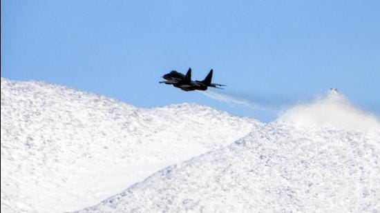 An IAF fighter jet seen flying in the backdrop of the snow-covered mountain, in Ladakh (File Photo) (ANI)