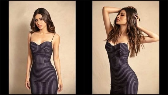 Mouni Roy slays an uber hot silhouette in a sultry power midi bodycon dress(Instagram/imouniroy)