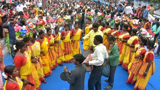 Matua community people dance and sing during a demonstration against chief minister Mamata Banerjee demanding for various facilities, in Kolkata on Saturday, during a protest rally