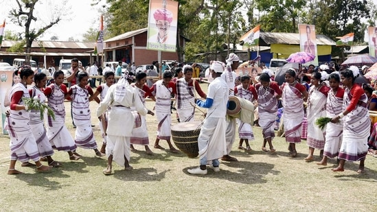 Artists perform Jhumar Dance during Congress leader Priyanka Gandhi Vadra's election campaign rally ahead of Assam Assembly Polls at Purabangla, in Golaghat on Monday. (ANI Photo)