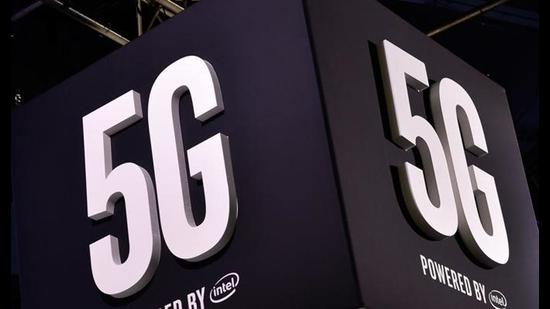 (FILES) In this file photo taken on January 9, 2018, signage for 5G technology is displayed at the Intel booth during CES 2018 at the Las Vegas Convention Center in Las Vegas, Nevada. China is slightly ahead of South Korea and the United States in the race to develop fifth generation wireless networks, or 5G, a US study showed on April 16, 2018. / AFP PHOTO / GETTY IMAGES NORTH AMERICA / David Becker (AFP)