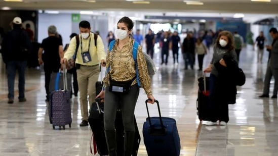 People wear protective face masks at Benito Juarez International Airport in Mexico City, Mexico.(Reuters)