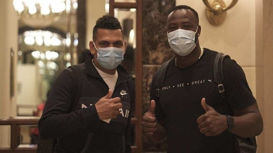 Andre Russell (right) and Sunil Narine arrive in Mumbai.(KKR)