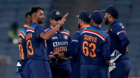 India's Prasidh Krishna, second left, and teammates celebrate their win in the first One Day International cricket match between India and England at Maharashtra Cricket Association Stadium in Pune, India, (AP)