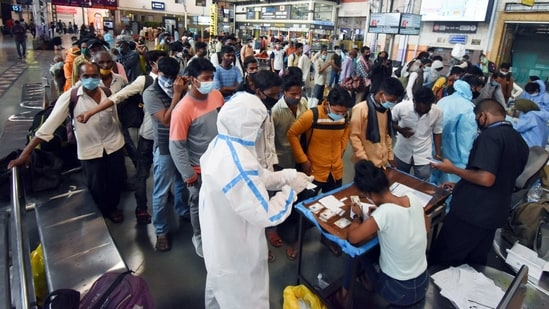Passengers stand in a queue for the Covid-19 test, at Chhatrapati Shivaji Maharaj Terminus in Mumbai on Wednesday. (ANI Photo)