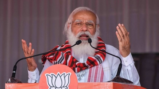 Prime Minister Narendra Modi gestures as he addresses a public meeting in Bokakhat on March 21.(AFP)