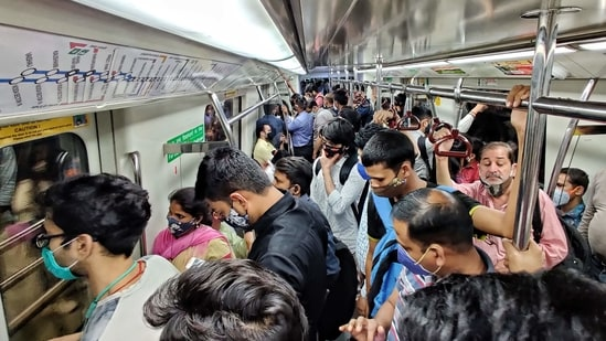 Heavy rush of commuters seen inside a Delhi Metro coach in clear violation of Covid-19 protocol, at Rajiv Chowk, in New Delhi, India, on Thursday, March 25, 2021. (Photo by Sanchit Khanna / Hindustan Times)