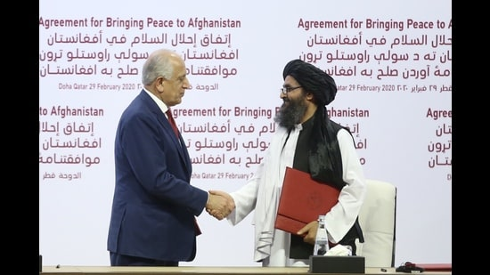 US Special Representative for Afghanistan Reconciliation Zalmay Khalilzad (L) and Taliban co-founder Mullah Abdul Ghani Baradar (R) shake hands after signing the peace agreement between US, Taliban, Doha, 29, 2020 (Anadolu Agency via Getty Images)