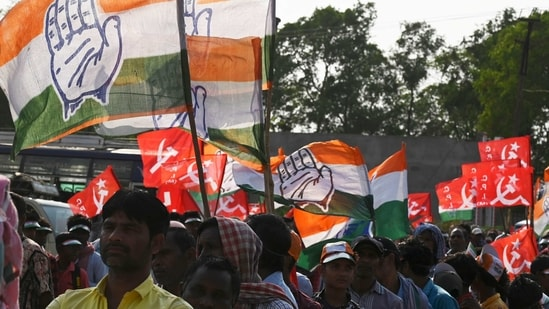 Activists of the Congress and the Left parties participate in the last campaign rally for the United Front candidate before the first phase of West Bengal's state legislative assembly election in Purulia, some 325 km west of Kolkata on March 25, 2021. (AFP)