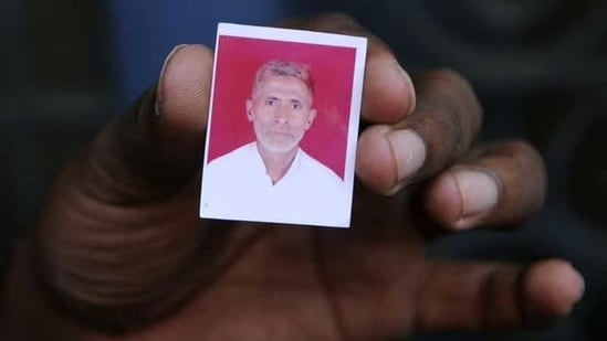 A relative holds a photograph of slain Indian villager Mohammad Akhlaq at his home in the village of Bisada, some 35 kilometres (22 miles) north-east of New Delhi.(AFP Photo)
