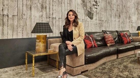 Gauri Khan poses in Shah Rukh Khan's office.