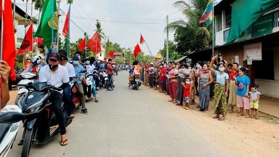 Demonstrators hold flags as they sit on motorcycles during a protest in Launglone, Dawei district, Myanmar March 26, 2021.( via REUTERS)