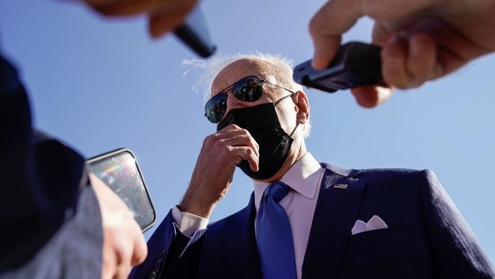 US President Joe Biden talks to reporters as he arrives at New Castle Airport in New Castle, Delaware.(REUTERS)