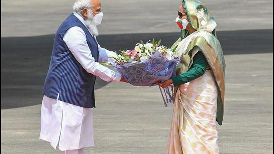 Prime Minister Narendra Modi being received by Bangladesh PM Sheikh Hasina, in Dhaka on Friday, March 26. (PTI)