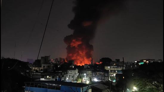 A large fire broke out in the Camp area in Pune late on Friday evening as seen from window in the vicinity. (HT PHOTO)