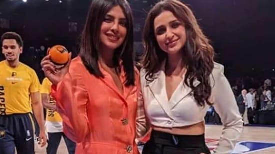 Parineeti Chopra and Priyanka Chopra pose together.