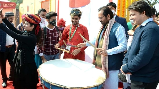 Union Minority Affairs Minister Mukhtar Abbas Naqvi beating a drum during the inauguration of Hunar Haat, in New Delhi. (ANI Photo)
