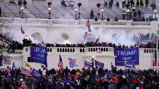 Violent rioters, loyal to Donald Trump, storm the Capitol in Washington.(AP / File)