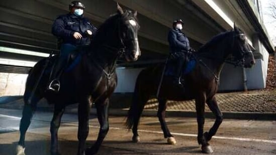 Mounted police patrol in a park in Warsaw, Poland.(AP)