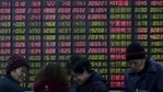 FILE PHOTO: Investors stand in front of an electronic board showing stock information on the first trading day after the week-long Lunar New Year holiday at a brokerage house in Shanghai, China, February 15, 2016. China stocks opened more than 2 percent lower on Monday, as they played catch-up with bearish global markets after the week-long Lunar New Year holiday. REUTERS/Aly Song/File Photo(REUTERS)