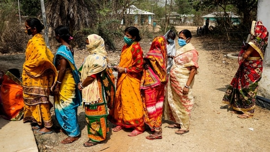 Women stand in a queue to cast their votes during the first phase of elections in Pirakata, West Bengal on Saturday, March 27, 2021.(AP)