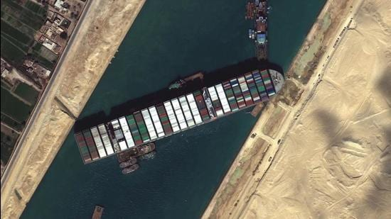 In the event that the MV Ever Given remains wedged across the canal for a longer period, the negative impact on the delicately balanced global supply-chain and oil prices will impose additional costs on the customer globally (AP)