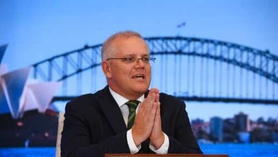 Morrison also praised India, saying the country is doing a 'tremendous job' in making vaccines, which are 'helping the broader world', (AP Photo)