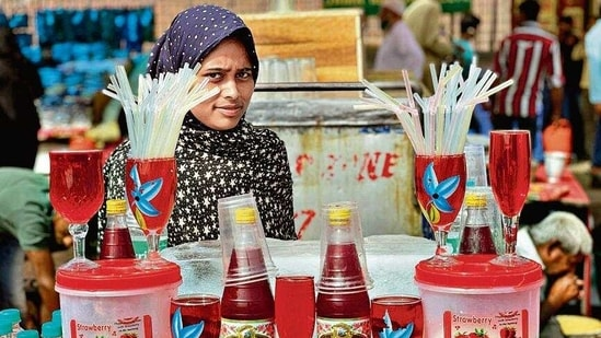 This is Mehboob Alam's 20-year-old stall, which sells roohafza in the summer and momos and carrot halwa in the winter.