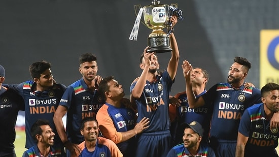Indian team poses with the trophy after winning the ODI series against England, at Maharashtra Cricket Association Stadium in Pune, Sunday,(PTI)